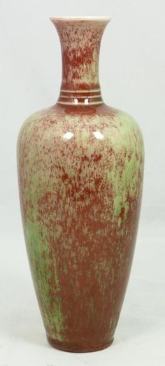 "A Chinese red and green flambe glaze vase. Bottom holds blue six character Kangxi reign mark. Measures 8 3/8"" height (21.2cm). Total weight of 462 grams."