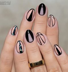 Play along with triangles in this interesting winter nail art. Use black and nude polish for the base and details while adding sequins as accent. Source