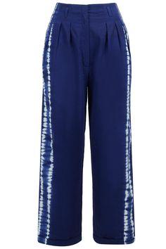Ink blue shibori pants BY IKAI BY RAGINI AHUJA. Shop now at: http://www.perniaspopupshop.com/ #perniaspopupshop #inkblue #shiboripants #gracious #leatherwork #detailing #love #fashion #style #chic #blue #musthave #attractive #ikai #RaginiAhuja #happyshopping