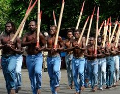 """Cargo Cults of Tanna. """"The most fascinating is the John Frum Movement. Worship is said to have originated with a soldier identifying himself as """"John from America."""" Annual celebrations are held on Feb.15. Men paint """"USA"""" on their chests & perform a hybrid of a military drill & dances w/wooden guns. They raise the American flag, build WWII planes out of grass & build a makeshift landing strip with the expectation that Frum will return with more cargo. Another tribe worships Prince Philip."""""""