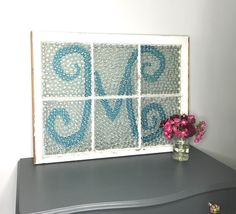 This is what Dollar Store gems and an old window can do for your decor