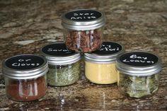 Organizing your spice drawer: Mason jars with chalkboard paint.  Do I like these more than my current method?  I do like a Mason jar...