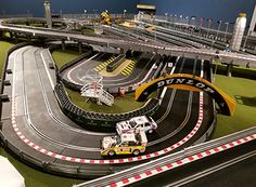 Check out these awesome slot track layouts from our customers. Slot Car Race Track, Slot Car Racing, Slot Car Tracks, Slot Cars, Rc Cars, Scalextric Track, City Model, Rally Car, Model Trains