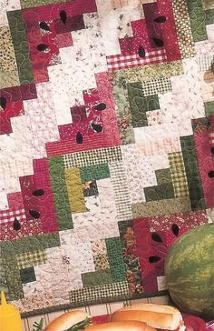 """53"""" x 60"""" A fun andEASY scrap quilt, perfectly sized for a picnic. Simple log cabin blocks with little seeds appliqued on top. The seeds are machine appliqued"""