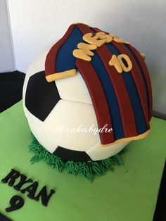 Soccer ball cake with messi jersey