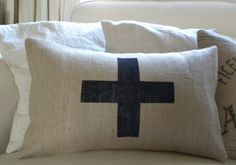 Burlap pillow cover with black swiss cross painted on the front.    Envelope enclosure at the back.    Takes pillow insert 12 x 20 (insert not