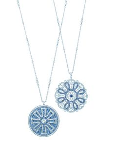 Tiffany & Co. medallion pendants of diamonds and Montana sapphires in platinum.
