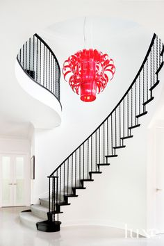 This vermilion Murano glass chandelier was found by the Chicago homeowners on a trip to Italy. #lighting #luxesource.com