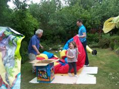 Getting the bouncy castle ready ! all excited. Picnic Blanket, Outdoor Blanket, Bouncy Castle, Beautiful Gardens, Picnic Quilt