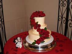 Ivory dot wedding cake with red roses