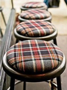 Looking for an easy way to add a little plaid? Recover stools in new fabric.