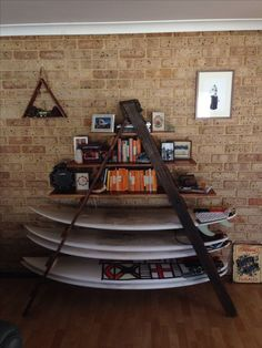 DIY bookcase and surfboard rack from old ladder.: OR make a shelf with the boards and old ladder