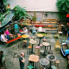 """Inside Szimpla Kert, one of Budapest's most well-known """"ruin pubs""""--hip bars that have been constructed out of former factories, tenements, and other dilapidated buildings."""