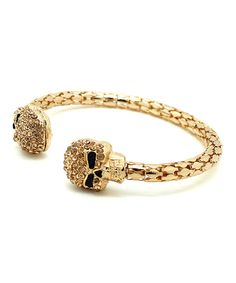 Look at this Goldtone & Black Glass Skull Cuff on #zulily today!