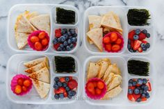 Quesadillas. Three have just cheese, one has chicken. The one made with corn tortillas is gluten free. On the sides they have seaweed snacks, tomatoes, strawberries and blueberries. Packed in Easy Lunchboxes.