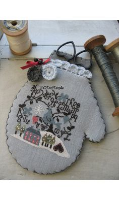 A lovely winter themed stitched mitten scissor keeper. #crafts #sewing #storage #stitchery