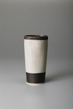 Beaker vase, Porcelain, manganese glaze, inlaid lines around the unglazed body. 6 3/8 in. (16.2 cm.) high, c.1970