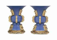 A PAIR OF ORMOLU-MOUNTED POWDER-BLUE VASES 19TH CENTURY, THE ORMOLU MOUNTS AND BASES LATER Each of wide gu form, applied with ormolu scrolls of variant designs
