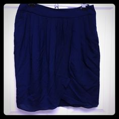 Navy blue skirt Worn twice! Beautiful navy blue skirt with some pleats. Has pockets! Mango Skirts Pencil