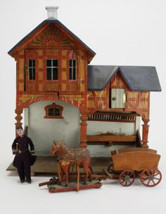 """Early Gottschalk stable with hayloft and upper room: painted and lithographed paper on wood, features include 2 stalls with hay rack and feed trough, above is room with opening facade with glazed windows; outfitted with 2 platform horses, a hay cart and a uniformed attendant - just as pictured on page 358 of Antique Dolls' Houses, Flora Gill Jacobs © 2005  17"""" x 20"""""""