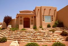 This type of home, immensely popular in the Southwest, has deeper roots than almost any other type of American architecture. It developed in New Mexico and Arizona around the turn of the 20th century, borrowing from the simple, sleek multifamily structures erected by the Pueblo Indians starting in 750 A.D. Most modern versions of pueblo architecture (also called pueblo revival) have a heavy Spanish influence.
