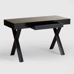 """The crisp lines and ample tabletop of our Black Josephine Desk make it one of our favorite stylish spots to sit and get things done. In bright, high-gloss black with """"X""""-shaped legs, and complete with a handy keyboard tray, it combines pretty with practical for a show-stopping look that's thoroughly functional."""