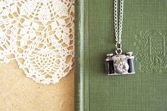 wishing - silver camera locket necklace.
