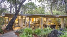 This midcentury modern home was constructed in 1955 and, in a way, doubles as a bridge. It's perched directly over a creek, just like three other homes by the same architect in the area. Glass walls and patios take advantage of the lush surroundings.