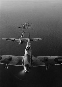 A squadron of Spitfires flying in loose line formation over the Adriatic Sea while on a bombing run to the Sangro River battlefront, circa 1944.
