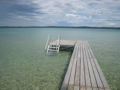 Crystal clear waters of Torch Lake at dock's end