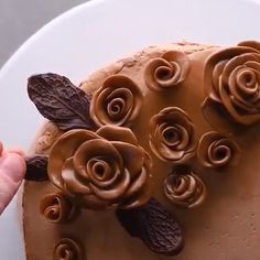 Love the tootsie roses and leaf technique This Chocolate Turtle Poke Cake is a moist chocolate cake soaked with caramel sauce and topped with caramel chocolate frosting and chopped pecans! It's a delicious poke cake recipe made completely from…View Post Poke Cake Recipes, Poke Cakes, Cupcake Cakes, Dessert Recipes, Cupcakes, Just Desserts, Delicious Desserts, Yummy Food, Tasty