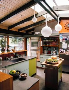 "Creative Revival of a Modernist Gem - Photo 2 of 14 - ""Maintaining sight lines to the outdoors and the adjacent den, we introduced a connectivity that transforms the kitchen into the center of family life,"" Alice Fung says."
