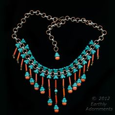 """What a great use of flower beads! """"Egyptian revival style necklace of vintage Czech glass beads.  A bib necklace composed of small flower beads, coral glass cylinders and rounds wired together to form a stunning fringe.  A 1940's design"""""""