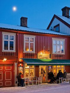NORWAY: Cute little coffee house in Trondheim. And only in Norway would they use the outdoor seating in the wintertime with snow on the ground.