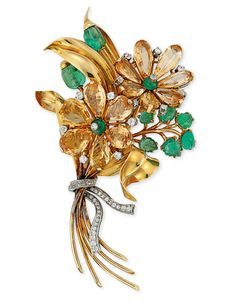 A GEM-SET FLORAL SPRAY BROOCH -  The two flowerheads composed of pear-shaped citrine petals interspersed with brilliant-cut diamonds and with emerald bead and diamond collet centres to the carved emerald leaves and diamond-set ribbon, circa 1950