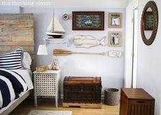 Unique Gallery Wall...part of a Rustic Nautical Master Bedroom Makeover via thinkingcloset.com