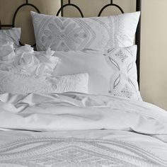 White & Gray bedding.  Just needs a splash of color, and it can change through the year! Love love!