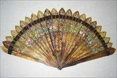 ortoiseshell fan of identically pierced sticks (alternately reversed to create a swag pattern) and guard. Both sides painted with swags of flowers. Cut steel rivet. c1810-2