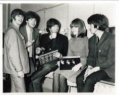 1st November 1964. The Beatles with 13-year-old Elizabeth Freedman, who left her home in Boston, Mass, to visit the London music. With Scotland Yard's help she was tracked down and George Martin promised that she could meet the band if she was found. True to his word she joined them  backstage at the Finbury Park Astoria.