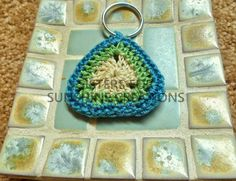White, Green, and Blue Crochet Keychain, handmade by Sisters for Sunshine Creations. www.sistersforsunshine.etsy.com
