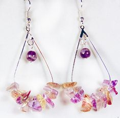 1955G - This listing is for a pair of amatrine earrings. Amatrine is a combination of amethyst and citrine (purple & yellow). Amatrine chips are at the base of the hoop and a round amethyst bead swings at the top.  Earrings are approx 2.5 in length  Most earrings for pierced ears