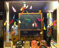Love the colored paper air planes  kids clothes window display | Dandelion KIDS, Vancouver, BC and Port Moody, BC.