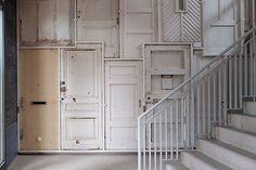 Piet Hein Eek installation for De Borneohof, a wall of recycled doors