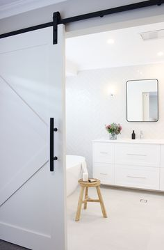 Who doesn't love a Barn Door? This one was custom made for us as part of the design to our beautiful Aubin Grove bathroom renovation. With just a hint of what's behind it in this pic, check out our website for more images from this reno! Bathroom Staging, Bathroom Renovations Perth, Bathroom Showrooms, Bathroom Interior, Bathroom Ideas, Boutique Bathroom, Cavity Sliding Doors, Making Barn Doors, Coastal Bathrooms