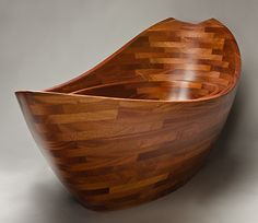 Solid wood boat shaped Salish Sea bath tub designed and built by Seth Rolland custom furniture design of Port Townsend, WA