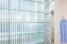 Studio David Thulstrup combines pale pink panels, glass bricks and birch veneer in this minimalist store in Copenhagen for designer Mark Kenly Domino Tan. Metal Clothes Rack, Grey Painted Walls, Daybed Covers, Glass Brick, Commercial Interiors, Retail Design, Brick Wall, Store Design, Interior Architecture