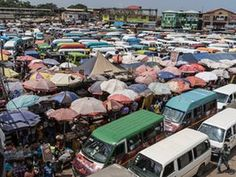 'Tro-tros' (shared minibus taxis) wait for passengers at Kaneshie market, a trading centre on the road west out of Ghana's capital, Accra.  Carl De Keyzer/Magnum Photos