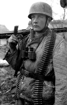 Portrait of a German Fallschirmjäger (paratrooper) with an MG 42, a 7.9mm general purpose machine gun, during the early days of the Battle of Monte Cassino. The Battle of Monte Cassino was a costly series of four assaults by the Allies against the Winter Line in Italy held by the Germans and Italians during the Italian Campaign that lasted for four months. The intention was a breakthrough to Rome. Although the Allies secured a victory, the Axis forces inflicted heavy losses; an estimated ...