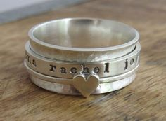 Perfect gift for the woman you love. This sterling silver spinner ring can be personalized with names or words of your choice making it one of a kind.