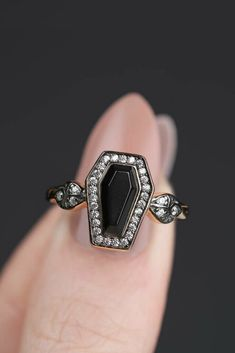Deep black Onyx coffin shaped gemstone set within a frame of cubic zirconia. Ornate shoulders sparkle with Cubic Zirconia crystals From Regal Rose #goth #coffinring #ad #macabre #coffin #blackring Unusual Wedding Rings, Alternative Wedding Rings, Couple Rings, Ring Finger, Black Rings, Macabre, Black Onyx, Coffin, Heart Ring